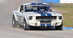 Curt Vogt in his Shelby GT350 is back on track after plowing through the grass for a little bit. Who cares if he deposited a lot of sand and gravel in the turn. Let the other drivers worry about it.  by Nigel Smuckatelli, via Flickr