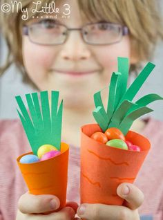 Cute carrot Easter baskets great for Easter egg hunts or to fill as gifts. Free printable from My Little 3 and Me.