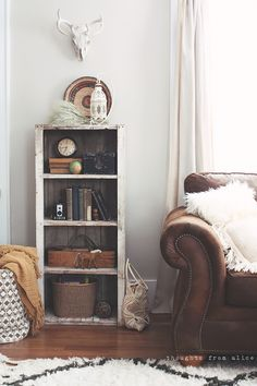 Rustic bookshelf styling with kids! Use the most of what you have when styling bookshelves!