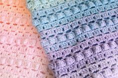 Our first crochet pattern! Rainbow Popcorn is a pretty baby blanket crocheted in colours of the rainbow. Full pattern and photos of popcorn stitch.