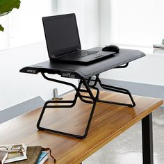 One of our most compact standing desk solutions, the single, slim work surface is 30 inches wide, so it's the perfect size for laptops or tablets. Desk For Two, Computer Stand For Desk, Laptop Desk For Bed, Stand Up Desk, Laptop Stand, Desk Riser, Adjustable Height Desk, Work Desk, Desktop Accessories