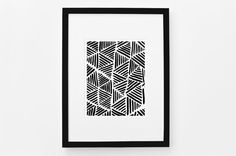 A bold addition to any space, this abstract art print features a geometric triangle pattern in contrasting black and white hues.  - Available in