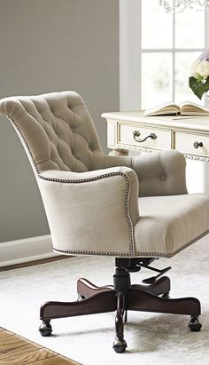 Button-tufted linen accented with silver nailhead trim defines the elegant Averly Desk Chair.