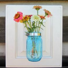 Combine a Cabinet Door and a Mason Jar for a Fun Wall Vase