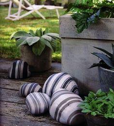 Paint the stones for a nice touch to your landscaping, if done right, it could be a great conversation piece... Ilike how these have the pillow ticking look.