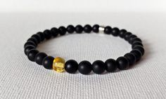 Check out this item in my Etsy shop https://www.etsy.com/ca/listing/500319450/natural-amber-bracelet-black-matt-onyx