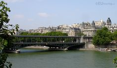 This photo shows a view of the Pont de Bir-Hakeim that passes over the River Seine and towards many architectural buildings.  To see more go to www.eutouring.com/pont_de_bir-hakeim.html