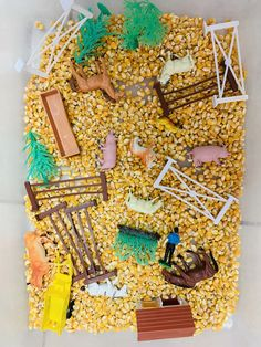 Sensory bin with farm animals and corn. Directions on how to make a pretend farm tractor with an engine for preschool dr. Farm Animals Tracing Coloring Pages Farm Animals Preschool, Preschool Decor, Farm Animal Crafts, Farm Crafts, Animal Crafts For Kids, Preschool Farm Theme, Toddler Crafts, Farm Activities, Animal Activities
