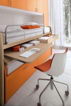 Fresh-Looking and Maximum Organized Boys room from Dielle. Space saving bunk bed with pull out desk, trundle bed and drawers.