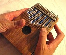 The Lamellophone, or thumb piano, is an early and very popular African instrument.  It is made up of a series of tongues.  The player presses down on the tongues and slides the finger off.  This creates a vibration from which the sound comes.