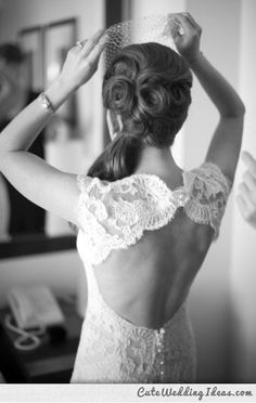I love the large pin curls in the back....not a fan of the side ponytail.... dress is beautiful too.
