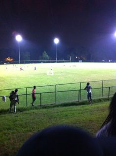 Look how Jamaicans swarm the football field.