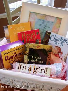 The BEST baby shower gift ever!! Build baby's first library with chapter books she can read herself someday! Moms usually get so many baby books, this is a sweet peek into the future. Love this book list and presentation idea.