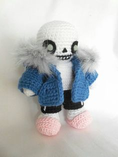 """*""""i've gotten a ton of work done today."""" *""""a skele-ton."""" sans is about 4"""" tall. Materials used include: Red Heart Soft Yarn in white; Valley Yarns Amherst in regatta blue; Louisa Harding Luiza in s..."""