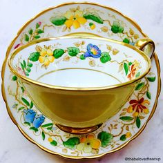 Stunning sunny yellow art nouveau Old English Royal Chelsea Staffs tea cup and saucer featuring elegant handpainted floral wreath details. Set is in excellent antique condition with no chips, cracks, or crazing.
