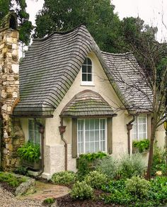 Love the roof, copper downspouts with reservoirs.