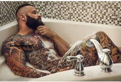would love to find a tattooed hunk like that in my bath
