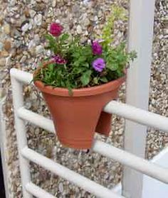 The Corsica Flower Bridge is an exciting variation on a traditional pot or a balcony planter. These planters are a great way to beautify balcony railings and fences, adding colorful flowers or herbs where plants could never grow before. The Corsica Flower Bridge actually fits on top of narrow railings, balcony railings, chain link fencing and any vertical divider up to 2.5 inches wide.