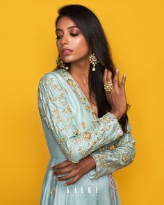 #MeriahCollection#TheFestiveEdit Presenting the best of post-wedding bridal look in crayon color, which is reinterpreted in vintage-inspired ways. This fit and flare 'Angrakha' silhouette is complemented by the baby blue hue and statement embroidery. The side-tie gives a modern look without compromising on the traditional vibes. Must-have for this festive season.✨ Fit And Flare, Angrakha Style, Post Wedding, Indian Designer Wear, Bridal Looks, Modern Fashion, Baby Blue, Hue