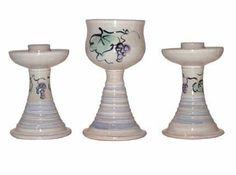 ArtisanStreet's Judaica Shabbat Set with Spiral Base. Includes Kiddush Cup and Candle Holders. Hand Built Stoneware. Limited Edition. by ArtisanStreet. $150.00. Limited edition. Individually hand crafted by artisan. Purchase for a gift or for yourself. 3-piece set includes Kiddish cup and two candleholders. Candleholders measure 6 inches; Kiddush cup is 7 inches. Shabbat Set with Spiral Base. Set contains 2 candleholders and Kiddush cup. Lead-free and dishwasher sa...