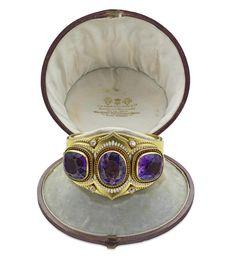 An enamel, amethyst and diamond bangle, circa 1870.