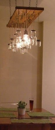 I was thinking about using mason jars as my lighting over the kitchen island but I like this idea much better!