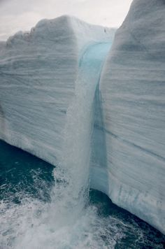 Svalbard has many beautiful waterfalls due to it's melting snow and ice.  Amazingly, it is inhabited by people with many small villages in which they live.  While there are no roads, snowmobiles are the main form of transportation.