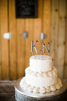 Knoxville Outdoor Wedding From Brittany Sidwell Photography - Two tier white wedding cake. Knoxville Outdoor Wedding From Brittany Sidwell Photography Wedding Cake Cookies, Buttercream Wedding Cake, Wedding Cake Decorations, Wedding Cake Designs, Wedding Cake Toppers, Purple Wedding Cakes, Wedding Cakes With Flowers, Elegant Wedding Cakes, Flower Cakes