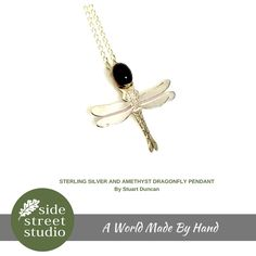 STERLING SILVER AND AMETHYST DRAGONFLY PENDANT  Stuart Duncan's Wren Silverworks jewellery is unusual in that it combines realistic line drawing with the medium of silver. Each brooch, earring, bracelet or pendant is individually engraved and finished to the highest of standards. Hand Crafted in Victoria, B.C.  Chain Length 18 inches. Pendant size 1.25 inches.