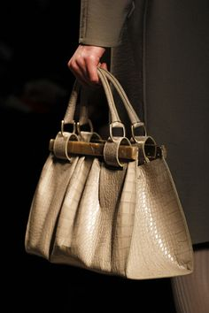 """Donna Karan not too interested in the beige snakeskin, but the wooden """"frames"""" are so cool!"""