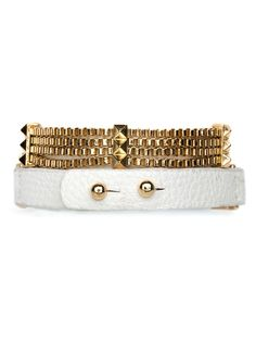 $28 The boho leather wrap bracelet gets a shot of glam in this stunning style. Not only does it feature a series of sun-kissed box chains and pyramid studs, but even the leather comes in luxe white for an added tony touch.