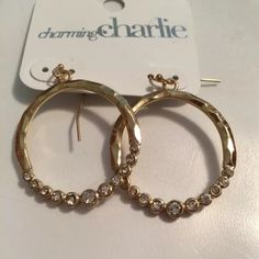 Dangling gold hoop earrings NWT! Gold dangling hoop earrings with clear stones along the bottom. Great accessory to add to any outfit. Charming Charlie Jewelry Earrings