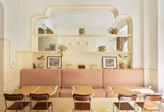 The all-day breakfast cafe has a colour palette of muted yellows, brown and cream hues, deliberately chosen to evoke the sun-drenched bars and cafes in more southern climates. Interior Pastel, Yellow Interior, Stockholm Restaurant, Sunnies Cafe, Bar Restaurant Design, Checkerboard Floor, Architecture Restaurant, Yellow Tile, Design Café