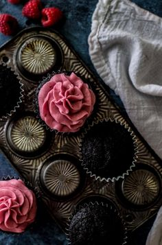 Decadent dark chocolate cupcakes with a fresh raspberry frosting We had a very dark and stormy Saturday.