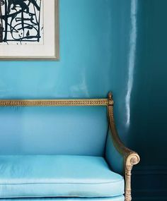 Most fabulous slice of deep robin's egg blue lacquer and leather and a wonderful punctuating piece of black and white art in this corner of a dining room by Suzanne Kasler.