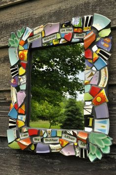 Mirror from broken dishes. I love the uses of colour. I want to learn how to put words under glass like this to use in projects.