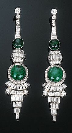 Pair of Art Deco Emerald and Diamond Ear Pendants  Each comprising two graduated cabochon emeralds within a circular and baguette-cut diamond surround to the graduated diamond line and collet surmount, circa 1940, with French assay and maker's mark, 7.5 cm long