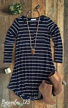 **NOTE** THIS ITEM WILL BE RESTOCKED ON 08/18/16. PRE-ORDERS WILL SHIP IMMEDIATELY UPON ARRIVAL. Great little basic Navy & White striped long-sleeved flare dress. Front pocket. Shown with the Arrowhea