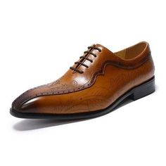 In Detail These lace-up oxford shoes get a unique design. Trendy by their floral design on their sides, they also are wise by their smart color. For sure, you'l