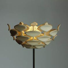 "Sven Eberwein developed an innovative 3D-printed lighting concept in his studio. Besides the new technological possibilities, nature is another source of inspiration for the designer. His free-standing luminaire ""Cynara SLS"", for example, impresses with its plant-like aesthetic with a modern design vocabulary. The light intensity and shape of the luminaire can be individually adapted by opening and closing the ""blossom""."
