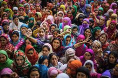 Kashmiri Muslim women shout anti-Indian and pro-Kashmir freedom slogans as they mourn during the funeral of Bilal Ahmad Bhat, 23, a civilian who was allegedly shot dead by Indian paramilitary Border Security Force (BSF) on August 12, 2015 in Larkipur #IWD2016