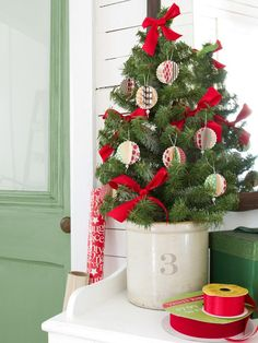 Craft Pretty Paper Ornaments  - Our 50 Favorite Handmade Holiday Decorating Ideas on HGTV