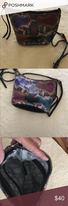 💜Aimee Kestenberg leather crossbody bag 💕NWOT Aimee kestenberg crossbody bag 🌸NWOT, colorful pebble leather snakeskin, gunmetal chain strap with leather comfort shoulder pad. Zippered closure, interior has one zip pocket and one slip pocket. Beautiful snakeskin print with purple, fuchsia, teal, brown and black. Aimee Kestenberg Bags Crossbody Bags