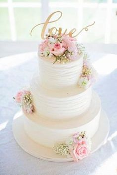 White, pink and gold wedding cake idea - three-tier white wedding cake with pink roses + gold LOVE modern calligraphy cake topper {Willow Noavi Photography} by agnes