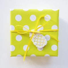 pineapple tag on polka dot gift wrapping paper