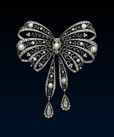 Belle Époque Pearl Stomacher Brooch by Chaumet, c. 1900. Chaumet,  platinum, gold, diamond, pearl, L134mm, W112mm. If a woman aspired to look like a queen at an important reception during the Belle Epoque then the stomacher brooch, as here, pinned to her breast was as essential as the tiara on her head. This all-white example, combining the shining splendour of the diamonds with the satin like sheen of the pearls was not only decorative and elegant but could be worn with dresses of every…