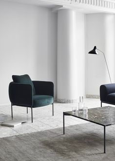 Furniture from Finnish brand Adea - minimal design - white walls - green velvet armchair