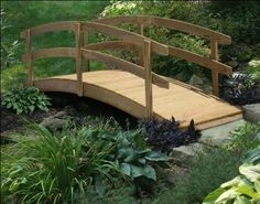 """3' x 4' Treated Pine Japanese Garden Foot Bridge by Fifthroom. $499.00. Made of pressure- treated pine w/ lifetime limited warranty against termites and decay fungi. 4 ft L x 3 ft W; 34"""" H (ground to top of rail); max span of 40""""; capacity: 400 lbs. Free Shipping. Hardware: Galvanized Nuts and Bolts. Protected by 2 year limited warranty. A Japanese Garden Foot bridge will bring whimsy and romance to any garden. Crafted from durable treated pine, the double rail..."""