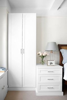 white built-in wardrobe and nightstand
