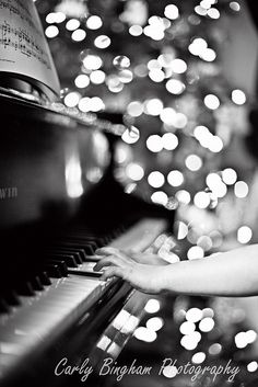 piano playing and christmas tree bokeh by Carly Bingham